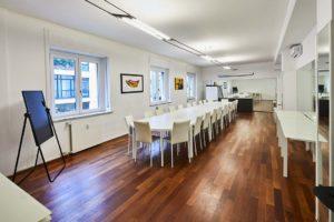 ufficio open sala riunione tavolo lungo spazi esclusivi